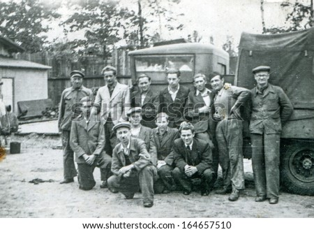 POLAND - CIRCA FORTIES: Vintage photo of group of workers in front of big lorry, Poland, circa forties