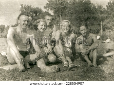 POLAND, CIRCA FORTIES: Vintage photo of people enjoying beach