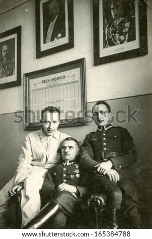 POLAND - CIRCA FORTIES: Vintage photo of three men in hospital, two of them in military uniforms, Poland, circa forties