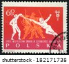 POLAND - CIRCA 1963: post stamp printed in Polska shows fencers and dragoons (musketeers) dueling in tournament, 28th world fencing championships Gdansk, Scott 1148 A402 60g red orange, circa 1963 - stock photo