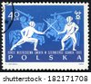 POLAND - CIRCA 1963: post stamp printed in Polska shows two fighting fencers and two knights in armor on horses, 28th world fencing championships Gdansk, Scott 1147 A402 40g blue, circa 1963 - stock photo