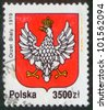 POLAND - CIRCA 1992: The stamp printed in Poland shows the stamp of tax collection, circa 1992. Emblem  of Poland with the image of a white eagle 1919 year. - stock photo