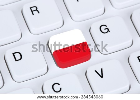 Poland flag online internet on computer keyboard - stock photo