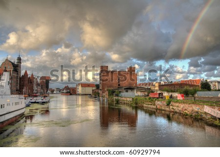 Poland - Gdansk city (also know nas Danzig) in Pomerania region. Old town view with Motlawa river and rainbow in HDR.