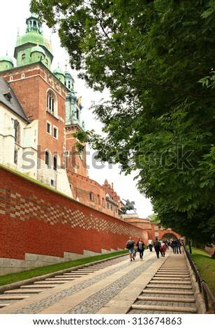 POLAND. KRAKOW - JUNE 27, 2015: Tourists on the background of the Wawel Royal Castle - the residence of Polish kings and rulers (from X to XVI century.).