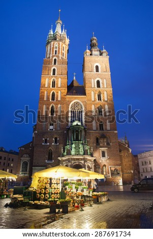 Poland, Krakow, Old Town, Main Market Square, St Mary Basilica (Mariacki Church) by night - stock photo