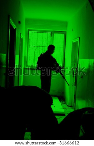 POLAND - MARCH 28 : View through the night vision device during a soldiers training (battle camp) to conduct an attack inside a building at night March 28, 2008 in Poland. - stock photo