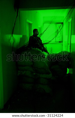 POLAND - MARCH 28 : View through the night vision device during a special military force training (battle camp) to conduct an attack inside a building at night March 28, 2008 in Poland.