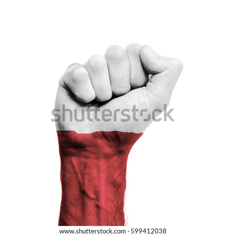 Poland national flag painted onto a male clenched fist. Strength, Power, Protest concept
