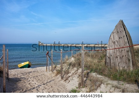 Poland, Pomerania, Hel, resort town at Baltic Sea and Puck Bay, entrance to the beach and pier, old fishing boat remains - stock photo