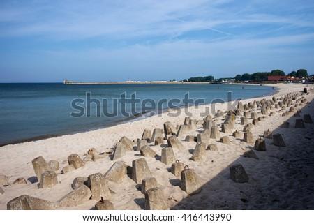 Poland, Pomerania, Hel, resort town at Baltic Sea, beach strengthened with concrete breakwater blocks - stock photo