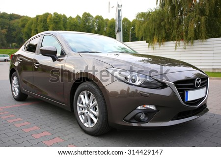 POLAND-SEPTEMBER 24, 2014: New Mazda 3 at the parking side in Poland. Mazda 3 is a popular compact car manufactured in Japan by the Mazda Motor Corporation.