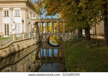 Poland.Warsaw.Poland.Lazienki Royal park in autumn.Palace on the water.View on the palace, canal and bridge with reflections in the water.Horizontal view. - stock photo