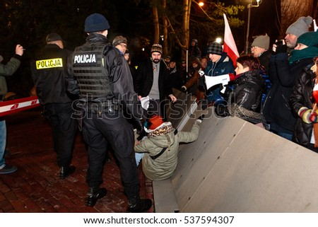 Poland, Warsaw. 16.12.2016. Polish people spontaneously gather near polish Parliament to protest against new polish goverment media policy. Protester falling down.