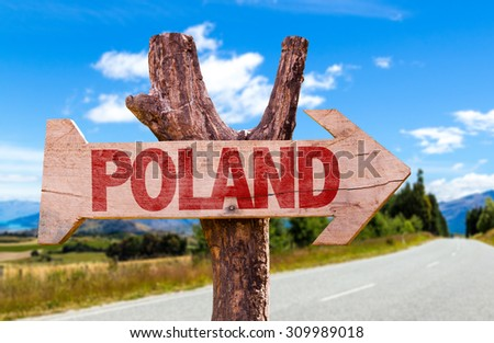 Poland wooden sign with road background - stock photo