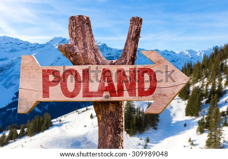Poland wooden sign with winter background - stock photo