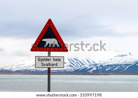 Polar bear warning signs in Svalbard, Norway - stock photo