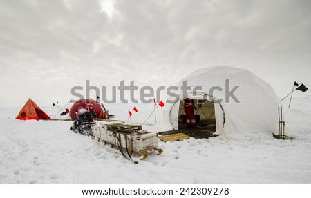 Polar research dive camp over a drifting ice floe in Antarctica - stock photo