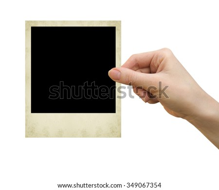 polaroid card blank in a hand on the white - stock photo