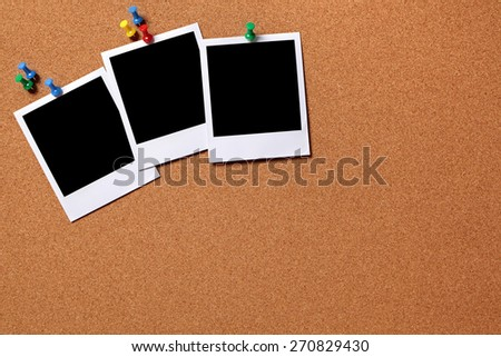 Polaroid frame photo print, thumbtack, cork board background.  Copy space - stock photo