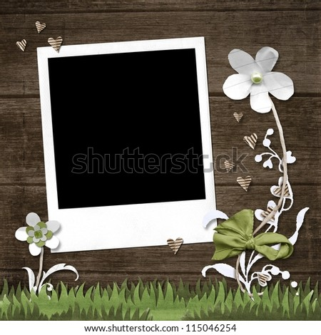 Polaroid photo frame and paper flowers on wooden board background - stock photo