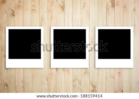 Polaroid photo frame on wood plank background - stock photo