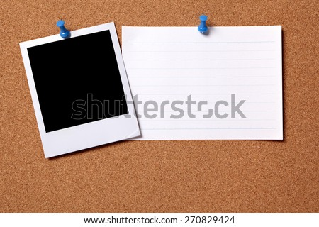 Polaroid photo print, pushpin, index card, cork.  Copy space - stock photo