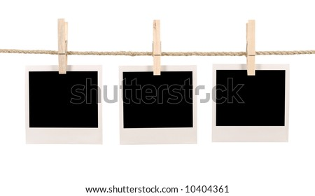 Polaroid string : group of three blank polaroid style instant camera photo prints hanging on a rope or string isolated on a white background.  Polaroid frame, instant photo.  Space for copy. - stock photo