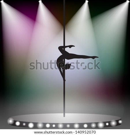 Pole dancer on stage with spotlights