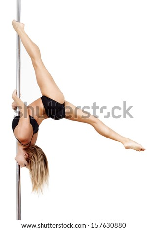 Pole dancer practice upside down, isolated - stock photo