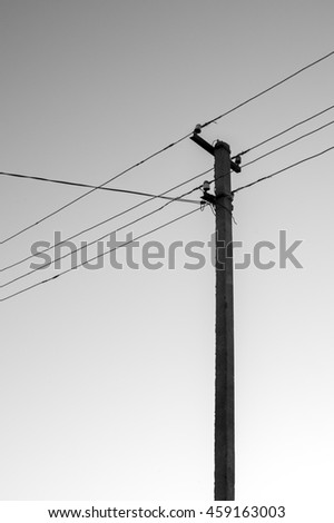 Pole with wires black and white