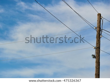 pole with wires in the village. sky and clouds