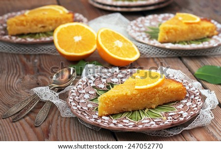 Polenta and lemon butter cake on a vintage plates on a wooden table. Selective focus - stock photo