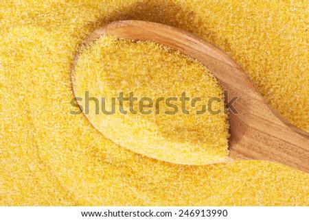 Polenta on a wooden spoon - stock photo
