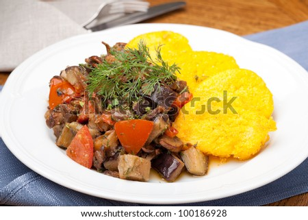 Polenta slices with vegetable stew