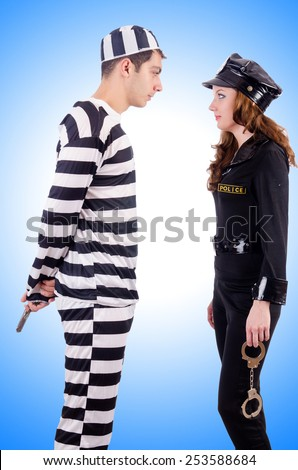 Police and prison inmate on white - stock photo