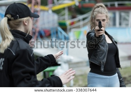 Police and woman going to kill somebody - stock photo