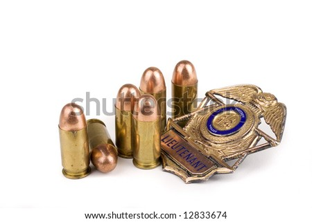 Police badge and bullets on a white background