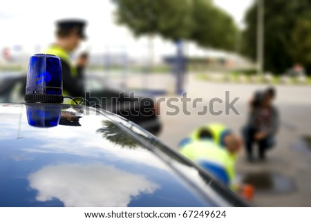 Police car at the scene of a car accident - stock photo