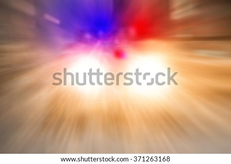 Police car going on emergency call with high speed in the city  - stock photo