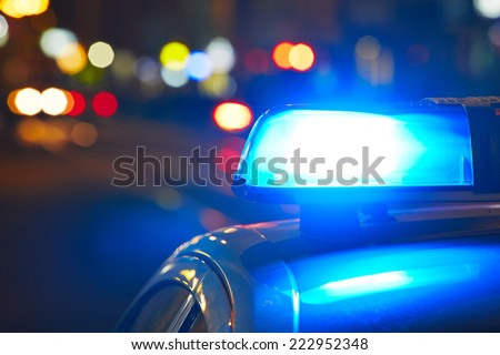 Police car on the street at night - stock photo