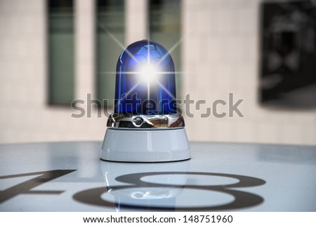 Police car with blue light - stock photo