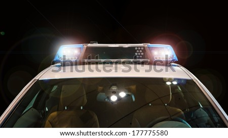 Police car with flash lights and siren on black - stock photo