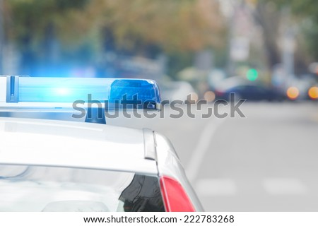 Police car with lights turned on. - stock photo