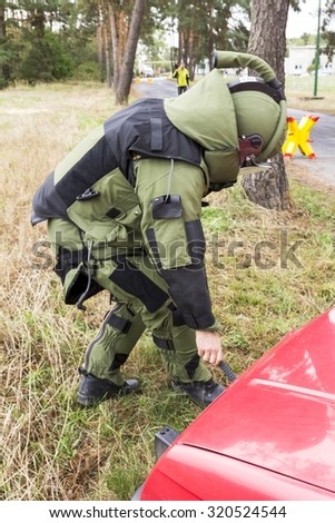 police explosives expert in action - stock photo