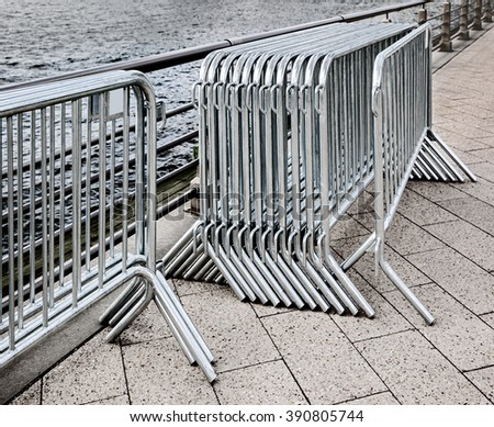 police fences barriers for crowd control - stock photo