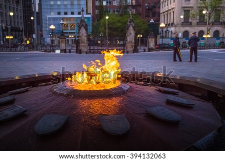 Police guards Centennial Flame & Peace Tower in Parliament building complex Ottawa