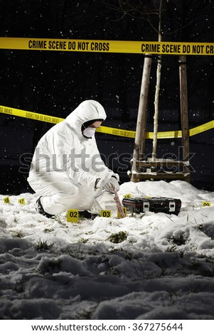 Police have no time - collecting of evidences in snow - stock photo