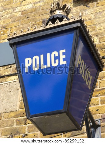 Police Lantern In England Outside The Station Or Headquarters - stock photo