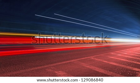 police light trails in tunnel. Art image . Long exposure photo taken in a tunnel - stock photo